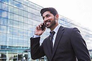a foreign investor on an EB-5 visa making an important phone call