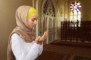 a woman on an EB-4 visa leading a prayer in the United States