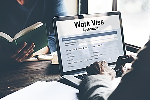 an immigration attorney helping an individual file an EB-4 visa application