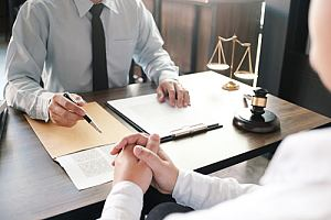 Attorney working with client