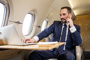 Business executive on plane