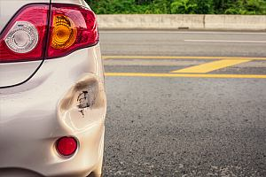 Car bumper suffering hit and run