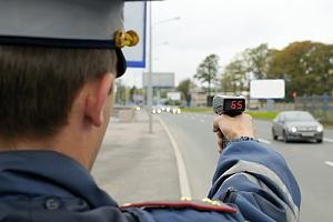 Cop checking cars for speeding