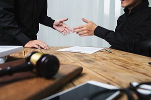 Criminal defense lawyer with client