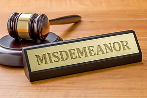 Gavel with a misdemeanor sign