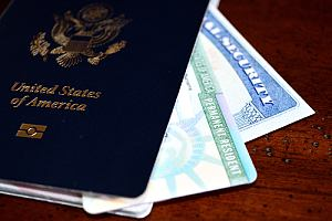 Green card with passport and social security card
