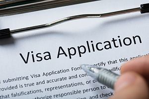 Person filling out visa application
