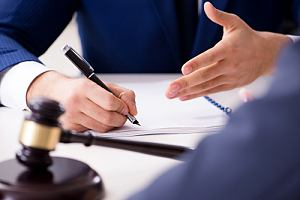 Traffic defense attorney with client