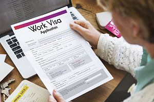 Woman looking over employment visa application