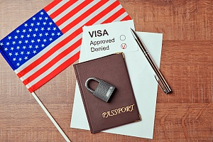 a passport and student visa documents with an american flag