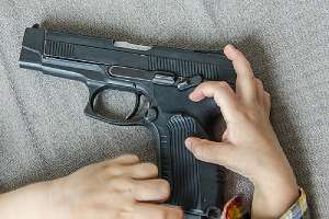 a firearm in a child's hands.Virginia Gun Laws 2020 can penalize you for leaving firearm in reach of children
