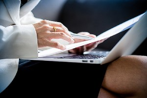 a woman reviewing documents. you can switch employers during your O-1 visa stay.