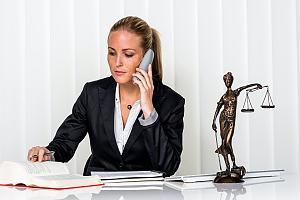 Criminal defense attorney on phone at her desk