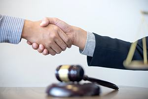 Criminal defense attorney with client