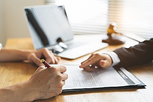 an immigration attorney assisting a client with an immigration waiver
