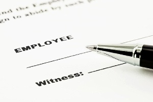 Employment contract and a pen. The application process for an EB-2 visa is complex