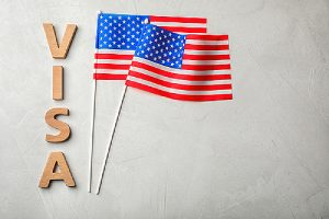 VISA and flags of USA on gray background