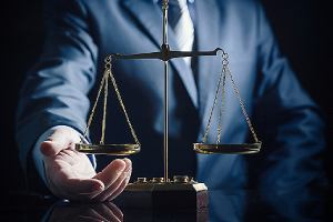 An employment law attorney and weight scale of justice. An attorney is critical in the EB-3 visa application process