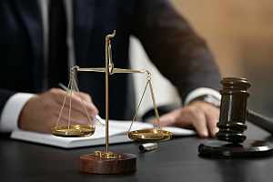 Immigration law attorney working at desk