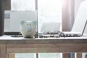 Piggybank with coins on table