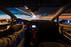 Man speeding down road