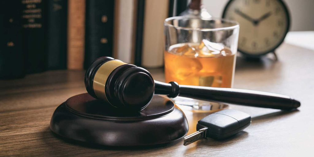 Gavel, drink and keys representing Virginia DUI penalties in 2021