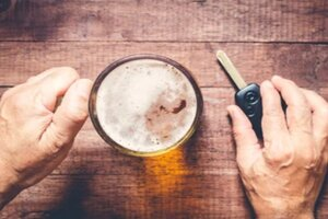 Man with Beer Mug and Car Key in Hand