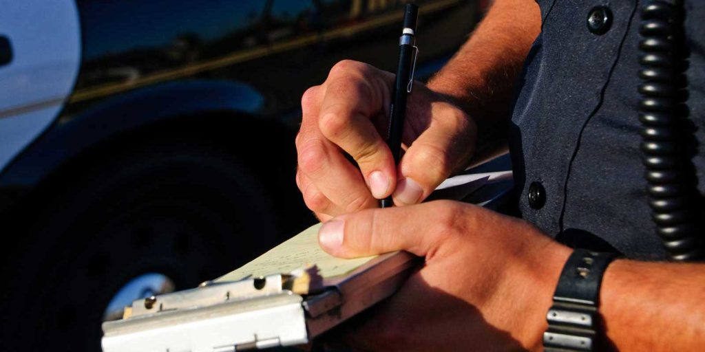 Police officer writing a reckless driving ticket in Virginia