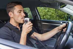 Repeat DUI offender having to blow into monitoring device to drive
