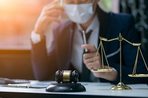 lawyer or judge wearing protective mask on the consult
