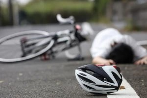 injured cyclist hit by another vehicle