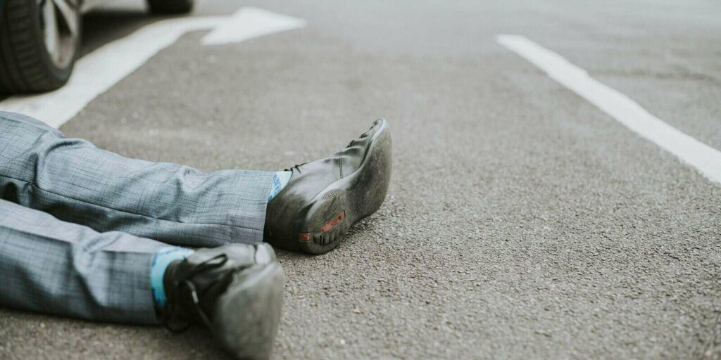 person lying on ground after accident