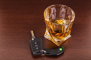 car keys and alcoholic drink owned by someone wondering
