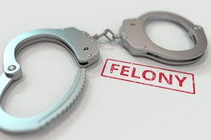 felony stamp and handcuffs