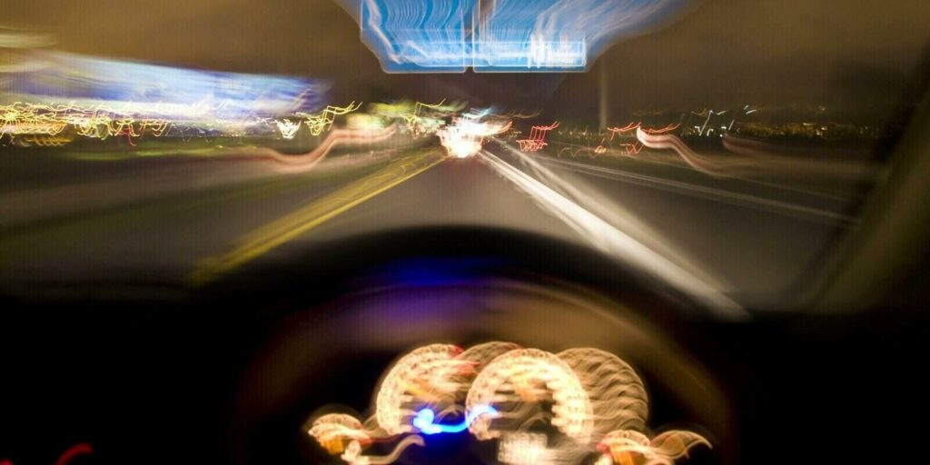 Driver speeding down the highway