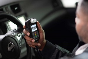 man holding a ignition interlock device asking how long do i need an ignition interlock device