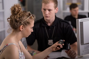 young woman holding breathalyzer